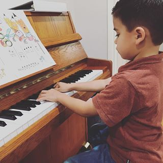 Young Piano Student In Lesson Long Beach